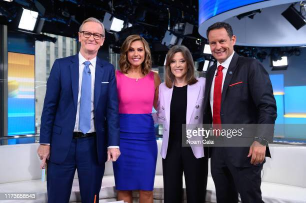 Steve Doocy Lisa Boothe Marianne Williamson and Brian Kilmeade pose for a photo during a taping of Fox Friends at Fox News Channel Studios on...