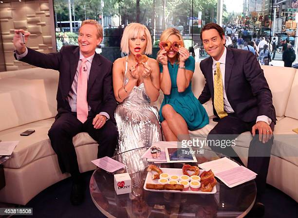Steve Doocy Rita Ora Elisabeth Hasselbeck and Clayton Morris have fun with heartshaped cronuts from Dominique Ansel Bakery as she visits 'Fox...