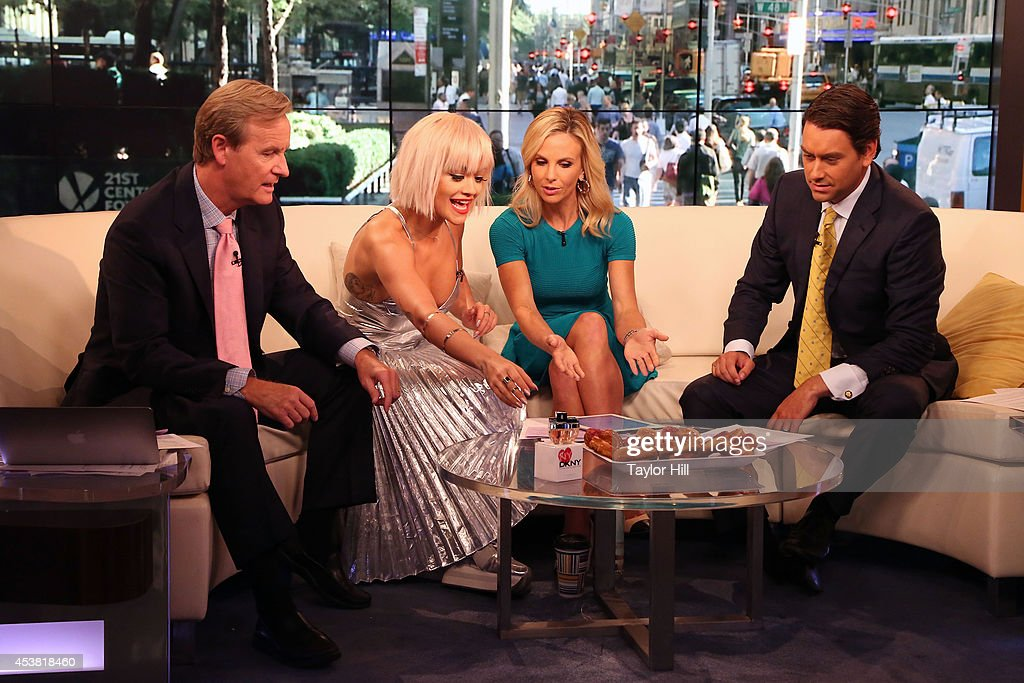 Steve Doocy, Rita Ora, Elisabeth Hasselbeck, and Clayton Morris prepare to enjoy cronuts as she visits 'Fox & Friends' at the FOX Studios on August 19, 2014 in New York City.