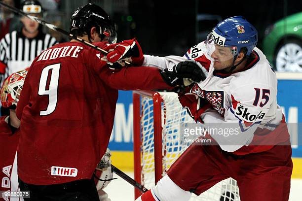 Steve Downie of Canada fights with Jan Marek of Czech Republic during the IIHF World Championship group F qualification round match between Canada...