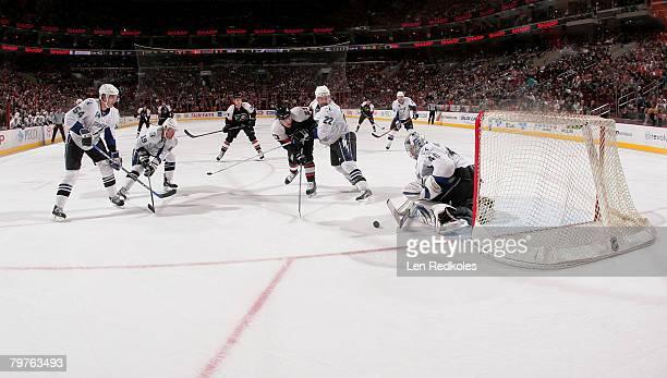 Steve Downie of the Philadelphia Flyers takes a shot on goal against Paul Ranger, Brad Richards, Dan Boyle and Johan Holmqvist of the Tampa Bay...