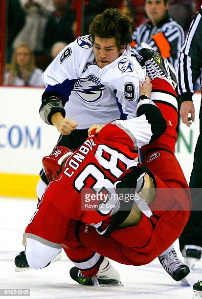 Steve Downie of the Tampa Bay Lightning knocks Tim Conboy of the Carolina Hurricanes down to the ice during the game on February 20, 2009 at RBC...