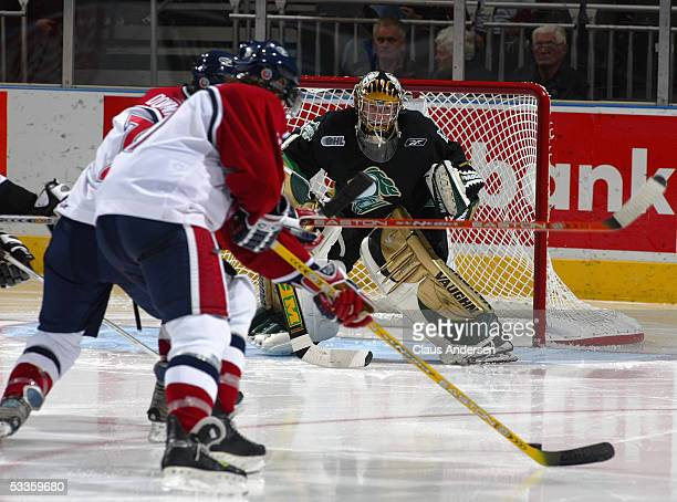 Steve Downie of the Windsor Spitfires prepares to shoot at goalie Ryan MacDonald of the London Knights during a Ontario Hockey League game at the...