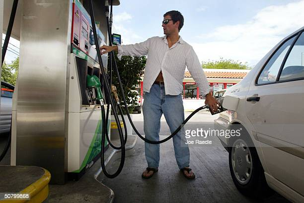 Steve Dudley puts gas into his automobile May 4, 2004 in Miami, Florida. The average price of regular unleaded gasoline in the United States is $1.84...