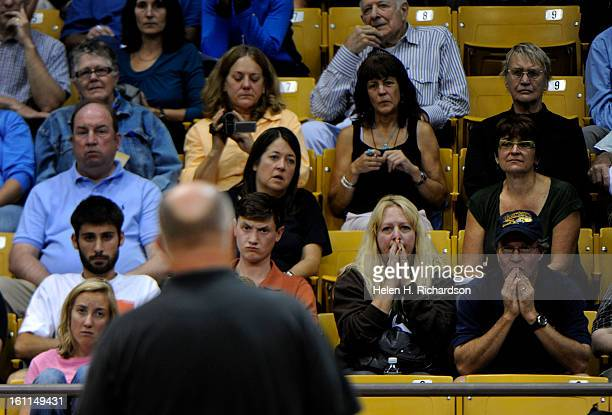 Steve Duke right and his wife Kelly Lyon listen to Sheriff Joe Pelle as he addresses questions about the fire The couple live in Boulder Heights and...