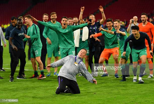 Steve Dukes the Tottenham Hotspur kit man celebrates victory with the players after the UEFA Champions League Semi Final second leg match between...