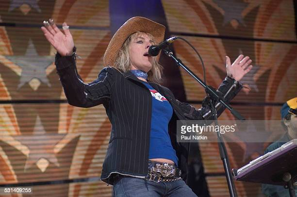 Steve Earle and Lucinda Williams perform at Farm Aid at the White River Ampitheater Seattle Washington September 18 2004