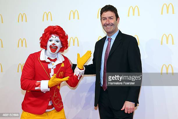 Steve Easterbrook CEO McDonald poses with Ronald McDonald during the new McDonald's Flagship Restaurant reopening at Frankfurt International Airport...