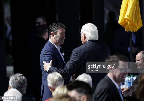 Steve Easterbrook chief executive officer of McDonald's Corp left greets an attendee during the opening of the company's new headquarters in Chicago...