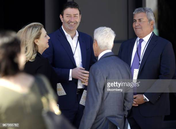 Steve Easterbrook chief executive officer of McDonald's Corp second left speaks with attendees during the opening of the company's new headquarters...
