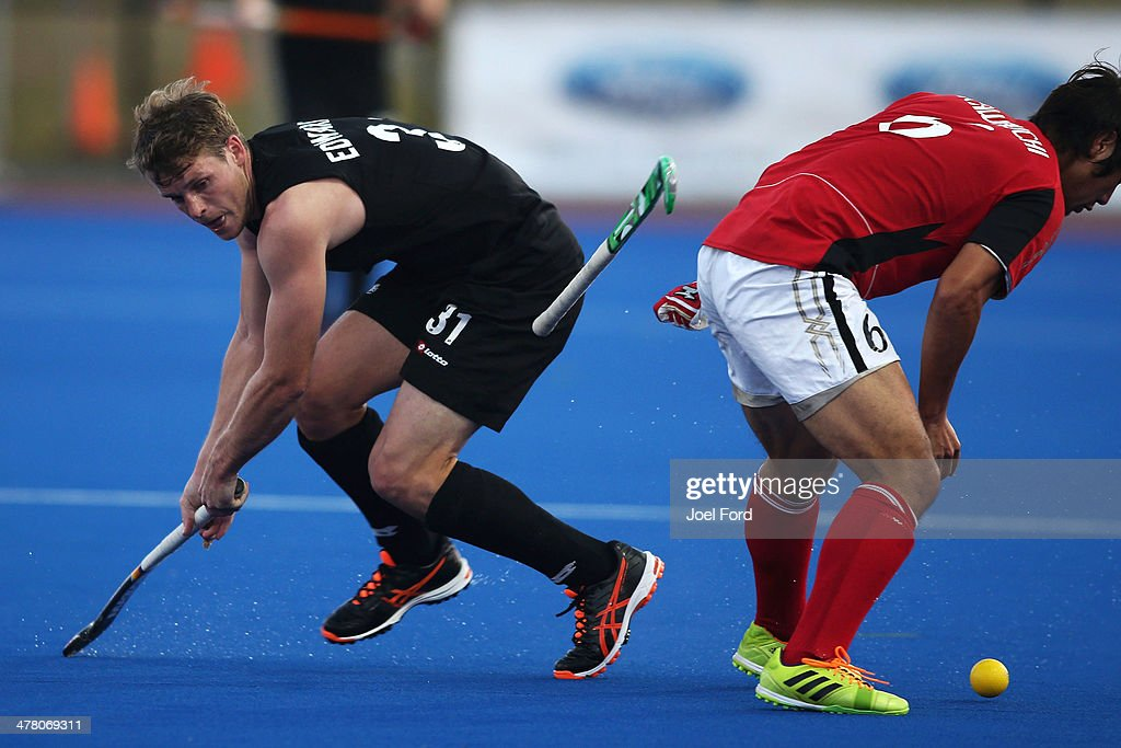 Steve Edwards of New Zealand and Shinji Kawauchi of Japan battle for the ball during the Test Match between the New Zealand Black Sticks and Japan at Blake Park on March 12, 2014 in Mount Maunganui, New Zealand.