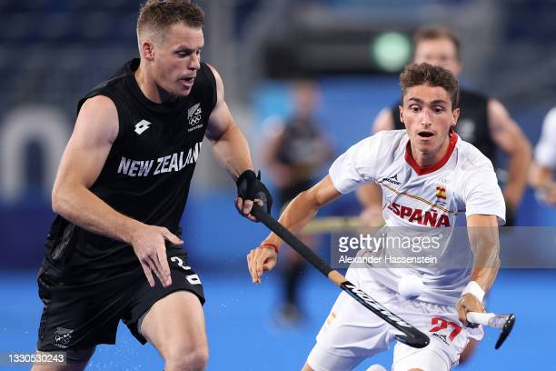 Steve Edwards of Team New Zealand and Gimo Bolto Bolto of Team Spain battle for the ball during the Men's Preliminary Pool A match between Spain and...