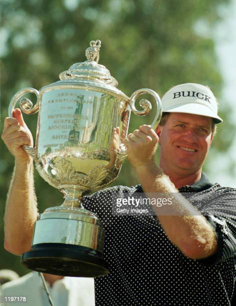 Steve Elkington of Australia lifts the trophy after victory in the USPGA Championship at the Riviera Country Club in Los Angeles California on August...