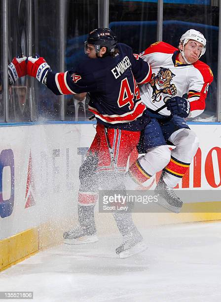 Steve Eminger of the New York Rangers collides with Tomas Fleischmann of the Florida Panthers at Madison Square Garden on December 11 2011 in New...