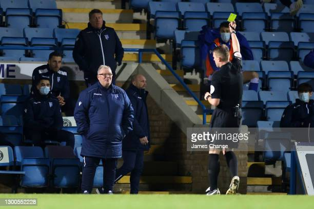 Steve Evans, Manager of Gillingham FC is shown a yellow card by referee Samuel Barrott during the Sky Bet League One match between Gillingham and...