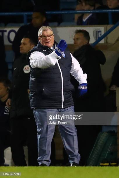 Steve Evans, Manager of Gillingham gives his team instructions during the FA Cup Third Round match between Gillingham FC and West Ham United at MEMS...