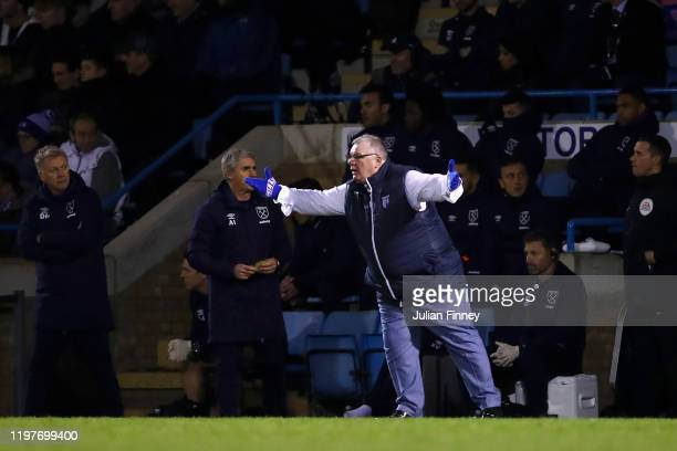 Steve Evans, Manager of Gillingham reacts as David Moyes, Manager of West Ham United looks on during the FA Cup Third Round match between Gillingham...