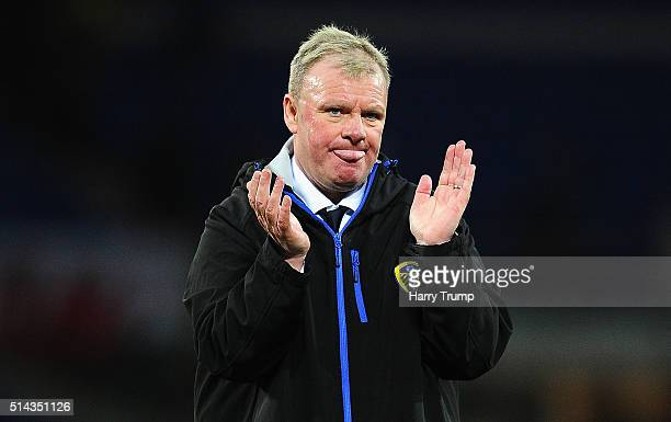 Steve Evans Manager of Leeds United applaudes the travelling fans at the final whistle during the Sky Bet Championship match between Cardiff City and...