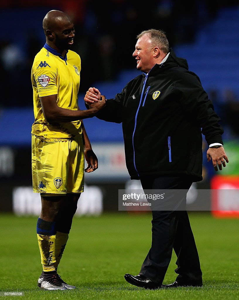 Steve Evans, manager of Leeds United celebrates his teams win over Bolton Wanderers with Souleymane Doukara during The Emirates FA Cup Fourth Round match between Bolton Wanderers v Leeds United at Macron Stadium on January 30, 2016 in Bolton, England.