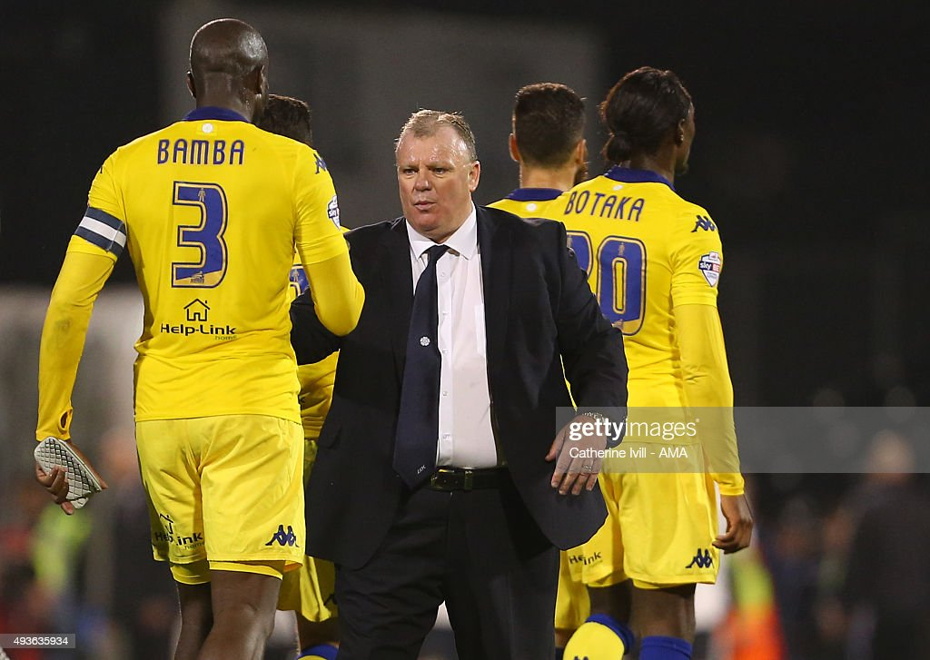 Steve Evans manager of Leeds United shakes hands with Souleymane Bamba of Leeds United after the Sky Bet Championship match between Fulham and Leeds United at Craven Cottage on October 21, 2015 in London, England.