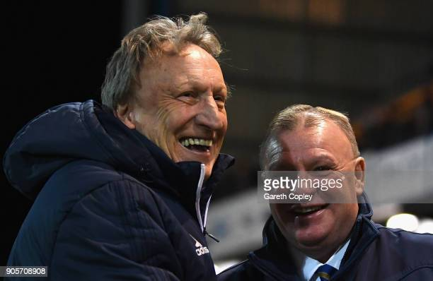 Steve Evans manager of Mansfield Town and Neil Warnock manager of Cardiff City look prior to The Emirates FA Cup Third Round Replay match between...