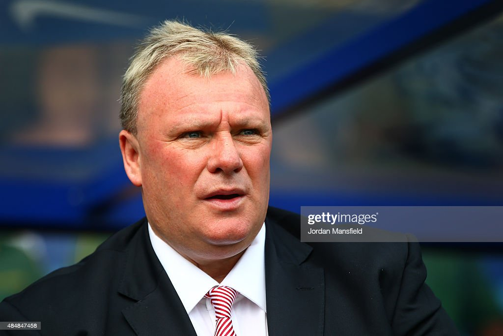 Steve Evans, manager of Rotherham United, looks on prior to the Sky Bet Championship match between Queens Park Rangers and Rotherham United at Loftus Road on August 22, 2015 in London, England.