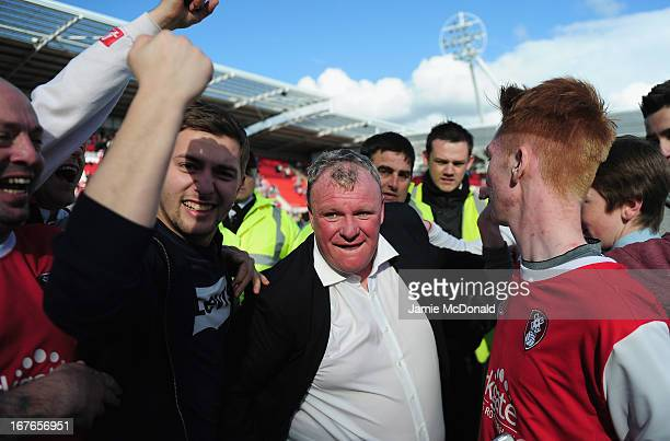 Steve Evans of Rotherham United celebrates promotion with the fans during the npower League Two match between Rotherham United and Aldershot Town at...