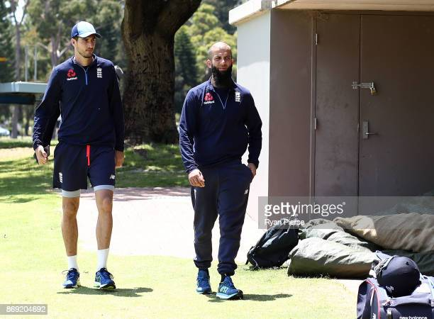 Steve Finn and Moeen Ali of England leave the ground for scans on injuries during an England nets session at Richardson Park on November 2 2017 in...