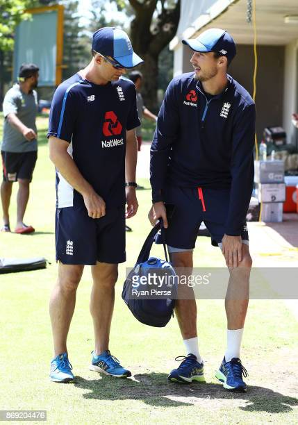 Steve Finn of England speaks to England fastbowling consultant Shane Bond after Finn injured his knee during an England nets session at Richardson...
