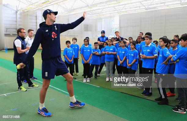 Steve Finn of England teaches local school children to bowl during the ICC Champions Trophy Cricket for Good clinic at Edgbaston on June 8, 2017 in...