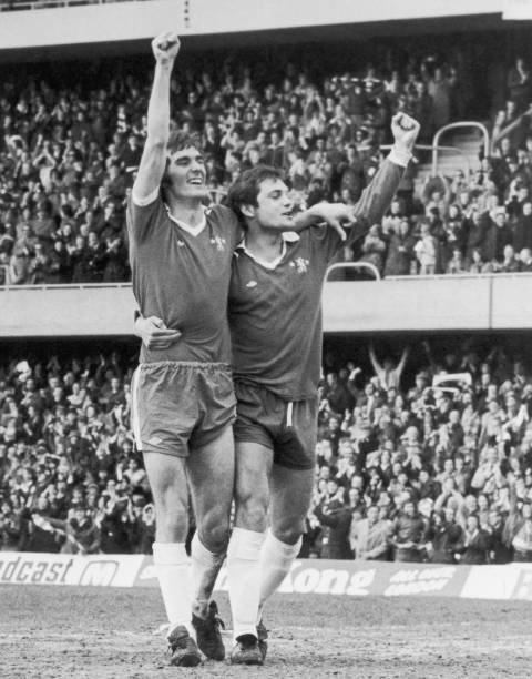 Steve Finnieston is congratulated by teammate Ray Wilkins after scoring Chelsea's first goal during a match against Luton Town at Stamford Bridge,...
