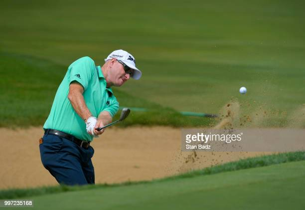 Steve Flesch plays a bunker shot on the seventh hole during the first round of the PGA TOUR Champions Constellation SENIOR PLAYERS Championship at...