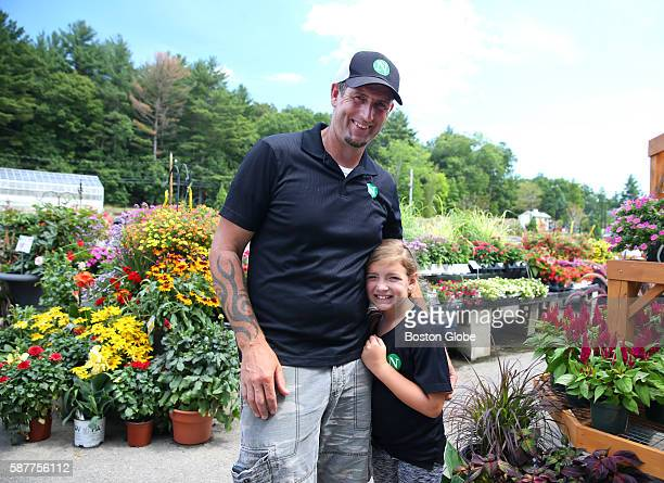 Steve Flynn and his daughter Kallie at Nunan Florist and Greenhouses July 30 2016 Nunan's opened an 18hole miniature golf course and ice cream shop...