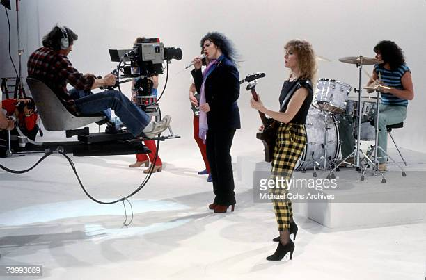 """Steve Fossen, Ann Wilson, Nancy Wilson and Michael Derosier of the rock and roll band """"Heart"""" in a film still from a music video in circa 1982 in Los..."""