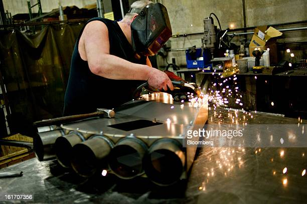 Steve Fossum tack welds a ventilation duct as it is assembled at the Giese Manufacturing Co in Dubuque Iowa US on Thursday Feb 14 2013 The US Federal...