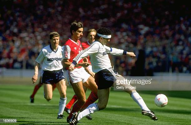 Steve Foster of Luton clears the ball away from Alan Smith of Arsenal during the League Cup Final at Wembley Stadium in London. Luton won the match...