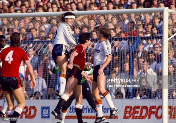 Steve Foster of Luton Town jumps above Frank Stapleton of Manchester United during a Canon League Division One match at Kenilworth Road on October 5...
