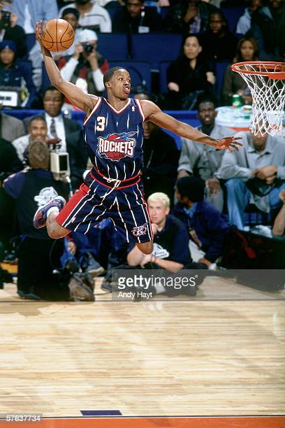 Steve Francis of the Houston Rockets attempts a tomahawk jam as he competes in the 2000 NBA Slam Dunk Contest at the Arena in Oakland on February 12...