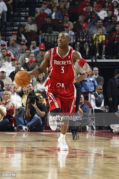 Steve Francis of the Houston Rockets drives against the Denver Nuggets during the game at the Toyota Center on October 30 2003 in Houston Texas The...