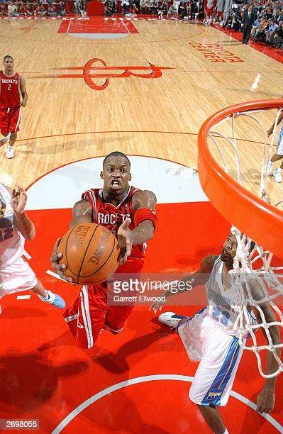Steve Francis of the Houston Rockets gets ready to shoot a layup against the Denver Nuggets during the game at the Toyota Center on October 30 2003...