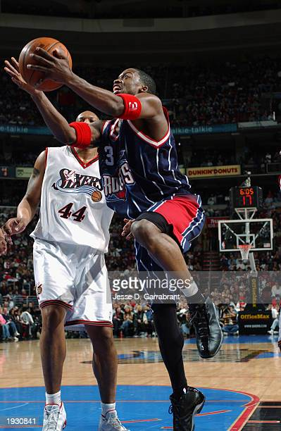 Steve Francis of the Houston Rockets goes to the basket against Derrick Coleman of the Philadelphia 76ers during the NBA game at First Union Center...