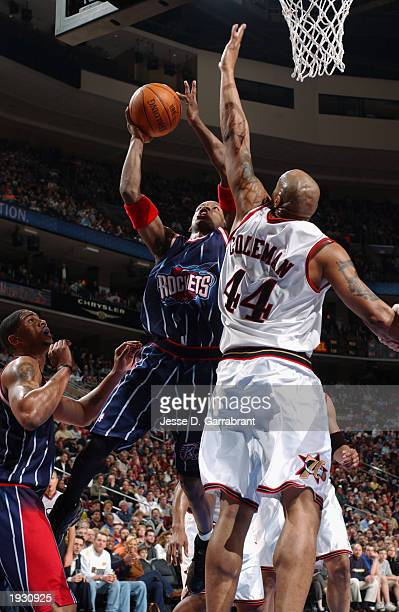 Steve Francis of the Houston Rockets goes up for the shot against Derrick Coleman of the Philadelphia 76ers during the NBA game at First Union Center...