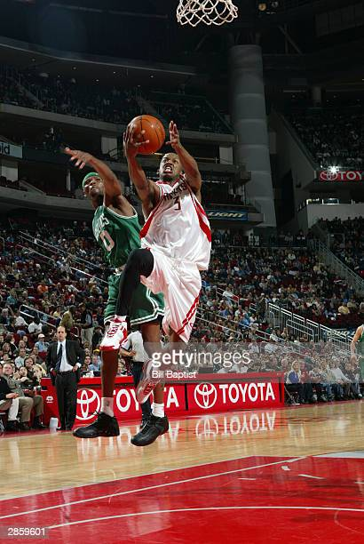 Steve Francis of the Houston Rockets shoots in front of Walter McCarty of the Boston Celtics on January 11 2004 at the Toyota Center in Houston Texas...