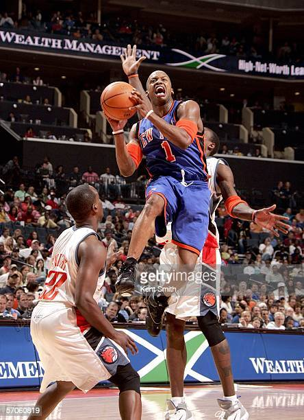 Steve Francis of the New York Knicks shoots over Brevin Knight of the Charlotte Bobcats on March 11 2006 at the Charlotte Bobcats Arena in Charlotte...