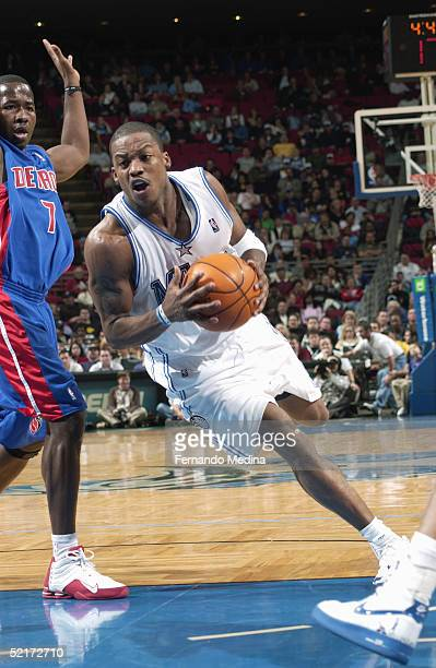 Steve Francis of the Orlando Magic drives around Anthony Goldwire of the Detroit Pistons during the game at TD Waterhouse Centre on January 18, 2005...