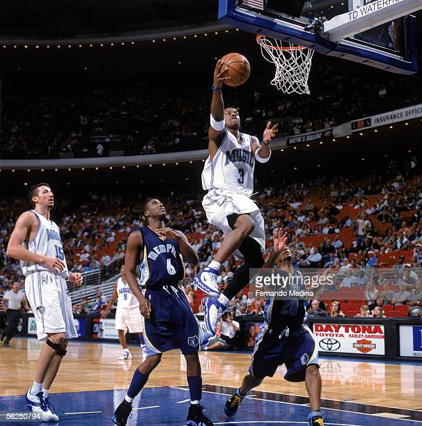 Steve Francis of the Orlando Magic drives to the basket for a layup past Eddie Jones and Damon Stoudamire of the Memphis Grizzlies during a game at...