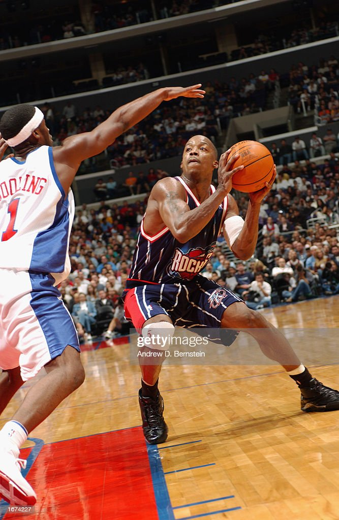 Steve Francis #3 of the the Houston Rockets pump fakes Keyon Dooling #1 of the Los Angeles Clippers during the game at Staples Center on November 24, 2002 in Los Angeles, California. The Clippers won 90-89.