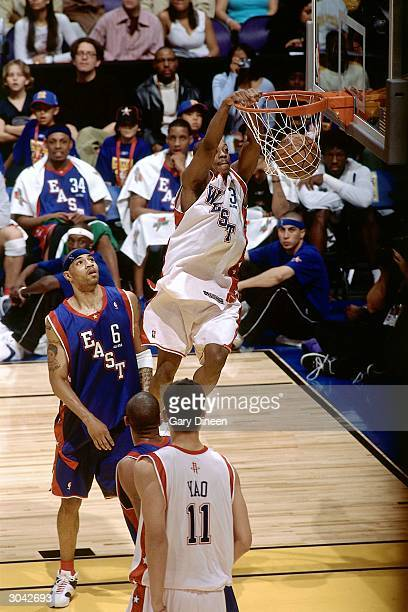 Steve Francis of the Western Conference AllStars dunks against Kenyon Martin of the Eastern Conference AllStars during the 2004 AllStar Game on...