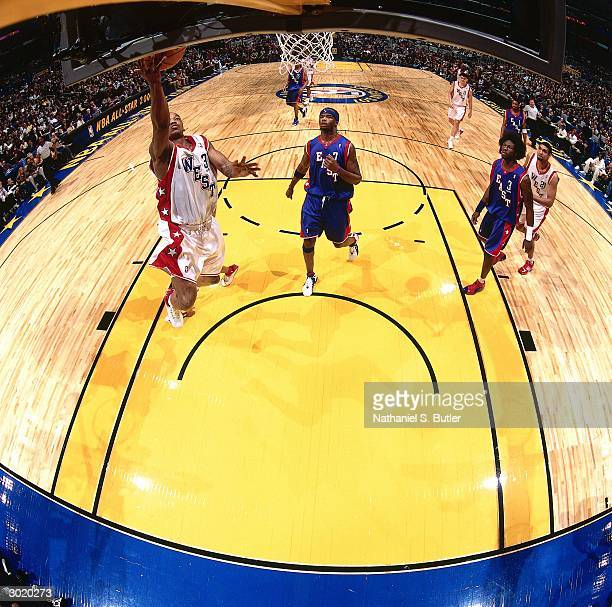 Steve Francis of the Western Conference AllStars lays up a shot against Ben Wallace of the Eastern Conference AllStars during the 2004 AllStar Game...