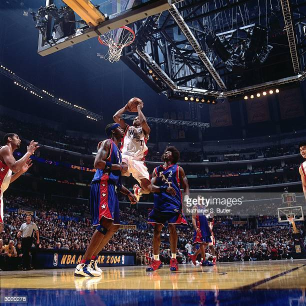 Steve Francis of the Western Conference AllStars shoots against Ben Wallace and Jermaine O'Neal of the Eastern Conference AllStars during the 2004...